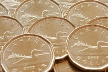 Canadian dollar continues to feel the pressure