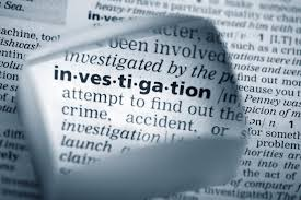 What should HR do with an alleged harasser during the investigation?