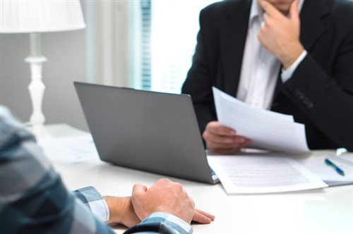 Can employers exercise rights under termination clause in fixed term contract?